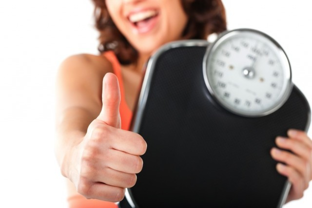 woman-happy-weight-loss-scale